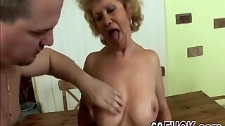 Slutty blonde granny gets down and dirty with tattooed guy