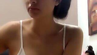 gorgeous young Thai girl in nightie in front of her webcam