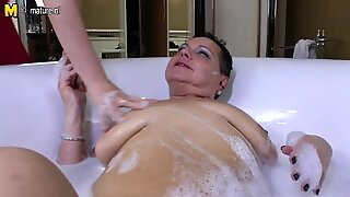 Daughter joins mature aunty in bath