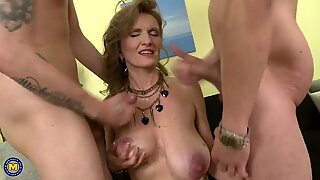 Adorable mature mom cum covered by two sons