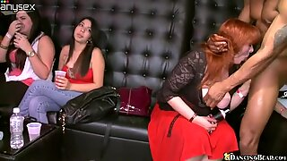 A group of horny women is sucking a delicious and fat cock
