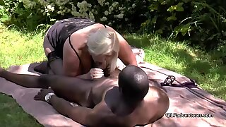 GILF Lacey Starr has sex with a powerful black outdoors