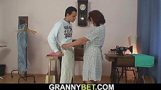 Sewing granny swallows customer'_s cock