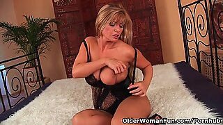 Mature mommy with big boobs plows a faux-cock