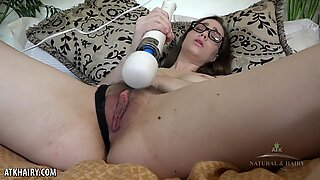Tali Dova hairy babe using a strong vibrator toy to cum